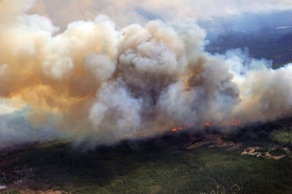 Alberta oil operations shut down as fires rage