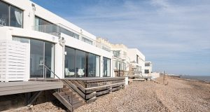 Rolling in the cash! Adele makes £350,000 profit by selling her Art Deco seafront villa on Brighton's Millionaire's Row