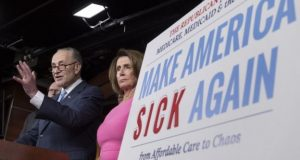 Obama urges fellow Democrats to fight for Obamacare